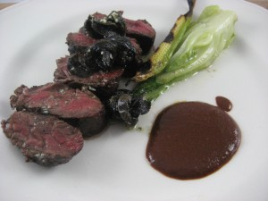 Marinated hanger steak, crunchy escargot, baby corn, bok choy and black olive mole