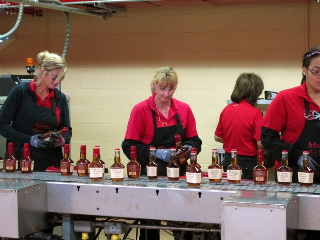 Dipping Maker's Mark bottles in wax