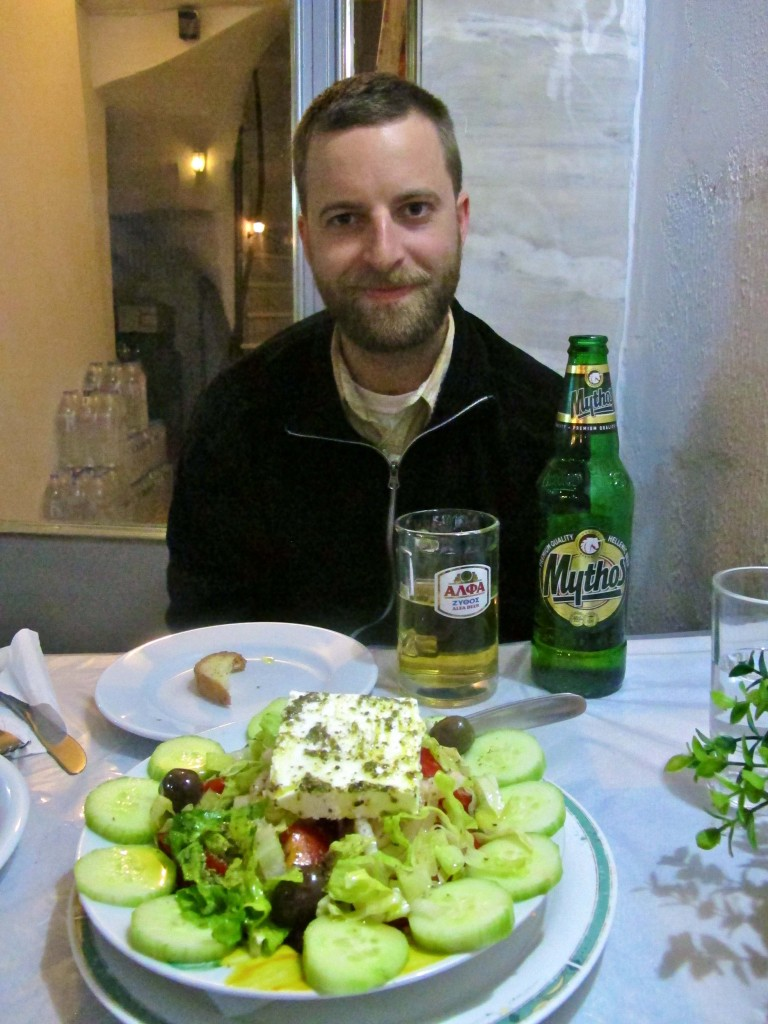 Rory enjoying a Mythos beer and a Greek salad