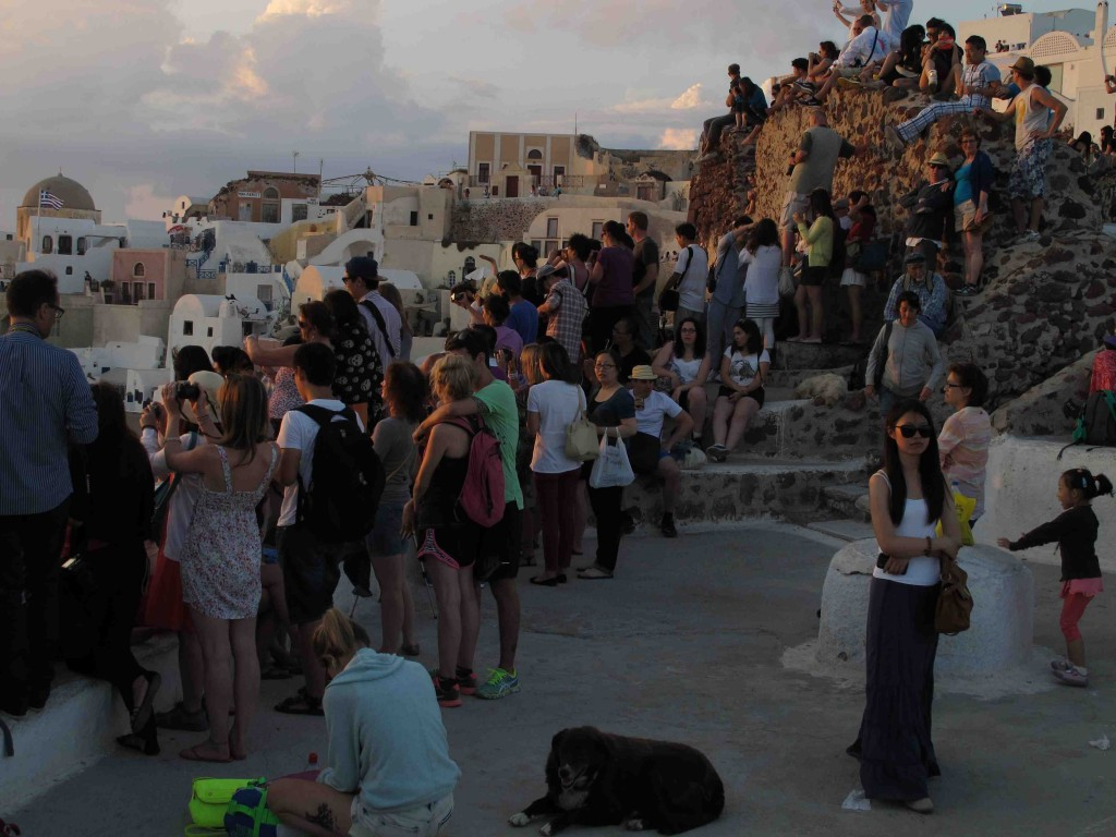 People waiting for the sun to go down in Oia