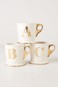 Anthropologies gold monogram mugs