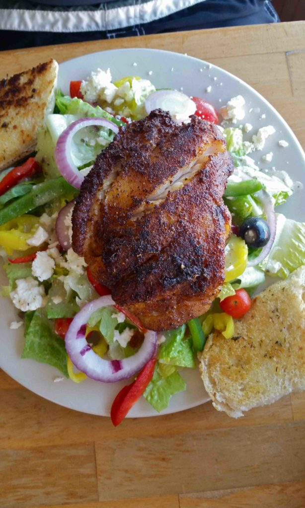Blackened grouper on Greek salad at City Pier Restaurant